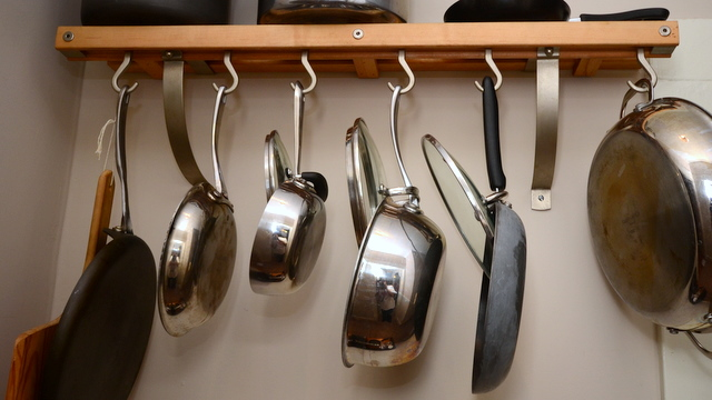 pots and pans into a cupboard