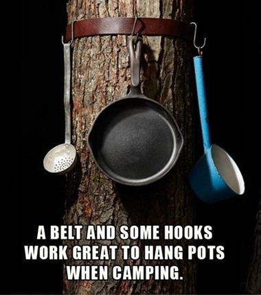 strapping a belt around a tree while camping